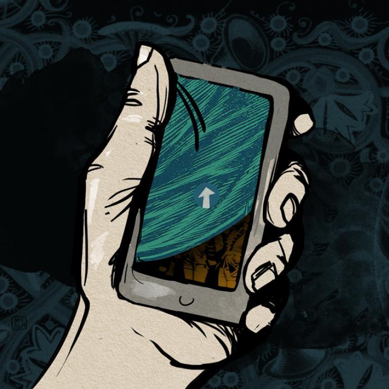Telefon komórkowy w dłoni